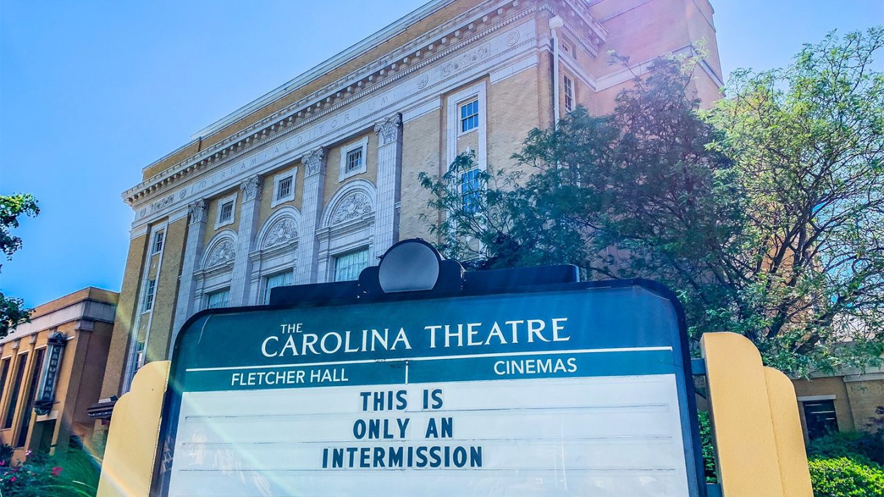 Carolina Theatre facade. Marquee reads, This is only an intermission.